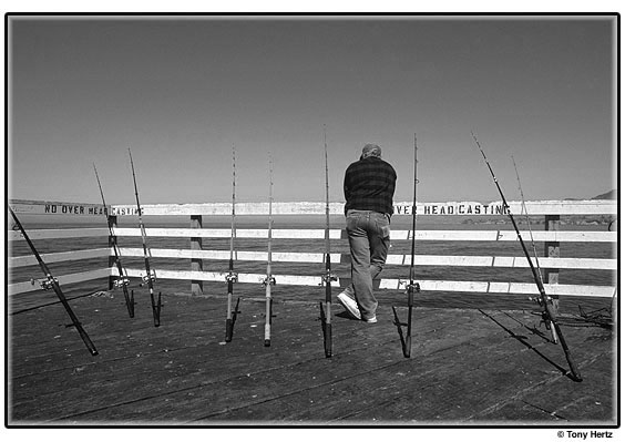 Fisherman with multiple poles.